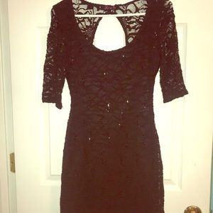 Black, backless sequin homecoming dress